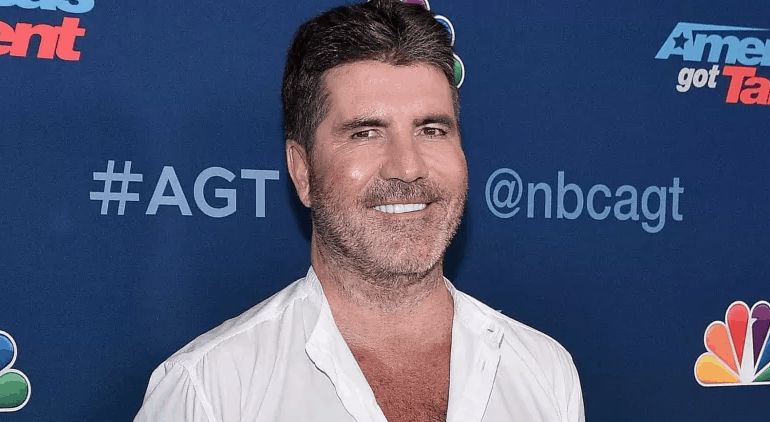Simon Cowell fractures his spine in an electric bicycle accident