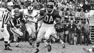Gale Sayers was equally electrifying on offense as he was on special teams.AP Photo